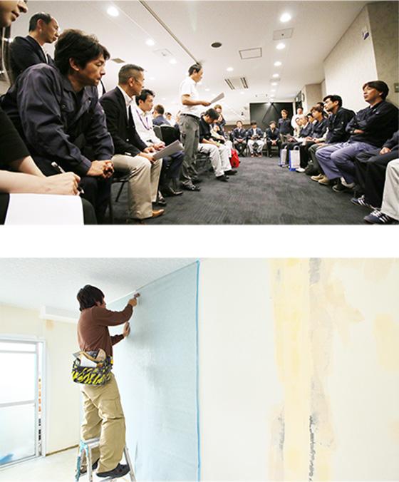 内装改修の現場でクロスを貼る朝日職人集団